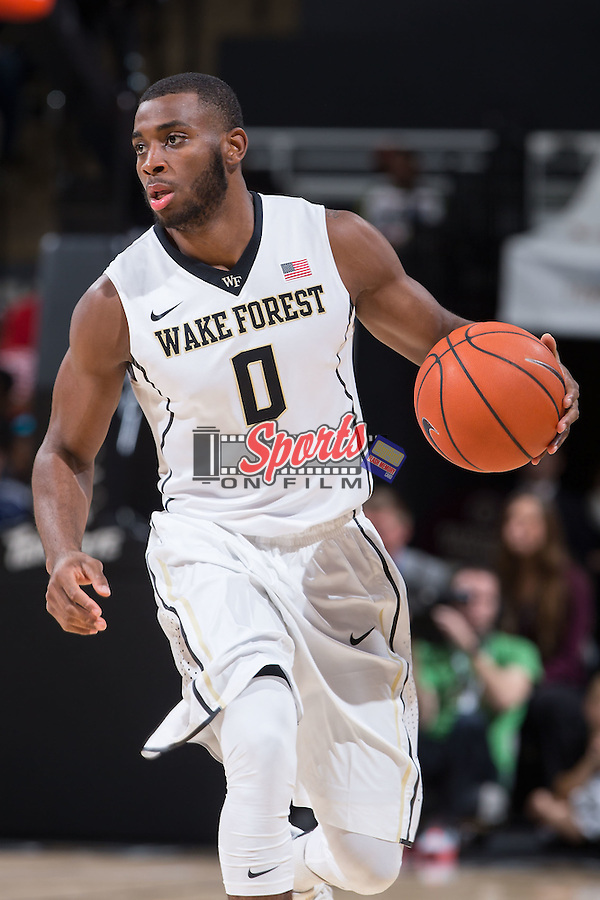 Codi Miller-McIntyre (0) of the Wake Forest Demon Deacons brings the ball up the court during first half action against the Coastal Carolina Chanticleers at the LJVM Coliseum on December 18, 2015 in Winston-Salem, North Carolina.  The Demon Deacons defeated the Chanticleers 83-77.  (Brian Westerholt/Sports On Film)