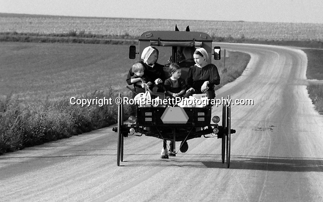 Horse and buggy with amish family on backroads of Pennsylvania, buggy, farm, Commonwealth of Pennsylvania, Penn, Penna, natives, Northeasterners, Middle Atlantic region, Philadelphia, Keystone State, 1802, Thirteen Colonies, Declaration of Independence, State of Independence, Liberty, Conestoga wagons, Quaker Province, Founding Fathers, 1774, Constitution written, Fine Art Photography by Ron Bennett, Fine Art, Fine Art photography, Art Photography, Copyright RonBennettPhotography.com © Fine Art Photography by Ron Bennett, Fine Art, Fine Art photography, Art Photography, Copyright RonBennettPhotography.com ©