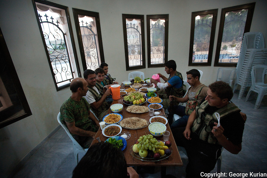 FSA soldiers begin their Iftar meal at Assas