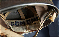 BNPS.co.uk (01202 558833)<br /> Pic: PhilYeomans/BNPS<br /> <br /> Trooper Edmunds steel helmet has recently been rediscovered.<br /> <br /> As the 75th anniversary of Operation Market Garden begins tomorrow, one of the original 'flower girl''s of Arnhem is still remembering...<br /> <br /> A heartwarming tale of dedication and rememberance has been revealed over a remarkable Dutch pensioner who still tends the grave of a fallen British Arnhem hero, 75 years after he perished in battle.<br /> <br /> Every year, Willemien Rieken (84) still lays flowers at Oosterbeek War Cemetery in memory of Trooper William Edmond, who was shot by a German sniper in the early stages of Operation Market Garden in 1944.<br /> <br /> Trp Edmond, of the elite 1st Airborne Reconnaissance Squadron's final words, uttered to two comrades who came to his aid, were 'tell my wife I love her'.<br /> <br /> Willemien was just nine years old when Oosterbeek became a bloody battleground in September 1944. The retired director's secretary, now aged 84, hid in a small cellar underneath her father's confectionary shop for five days while fierce fighting raged around their house and garden.<br /> <br /> Twenty-five of her family, friends and neighbours packed into the confined space and cowered in fear in the deafening din of shooting and explosions.<br /> <br /> After the war the grateful citizens of Arnhem arranged a poignant ceremony involving a nine year old Willimein and other school children from the town, to lay flowers at the graves of the British soldiers killed in the battle. <br /> <br /> And the dedicated pensioner is now one of the last survivors to still undertake the task.