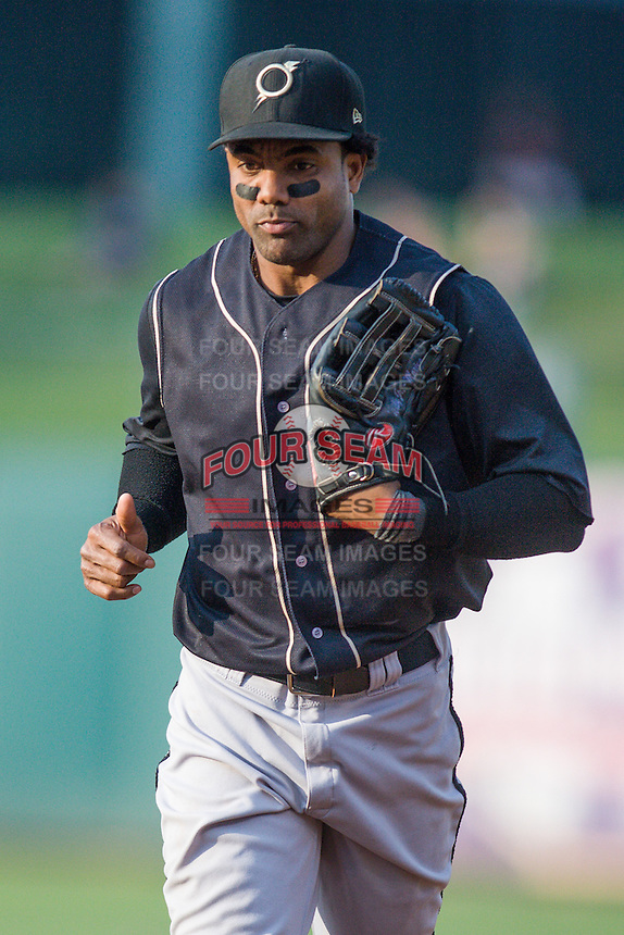 Omaha Storm Chasers left fielder Willy Taveras (3) heads to the dugout during the Pacific Coast League game against the Oklahoma City RedHawks at Chickashaw Bricktown Ballpark on June 23, 2013 in Oklahoma City ,Oklahoma.  (William Purnell/Four Seam Images)
