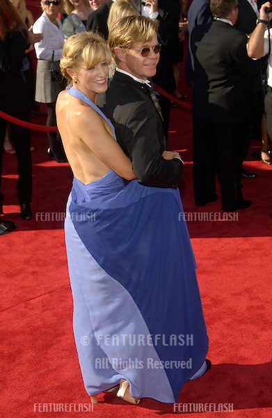 WILLIAM H. MACY & FELICITY HUFFMAN at the 55th Annual Primetime Emmy Awards in Los Angeles..Sept 21, 2003