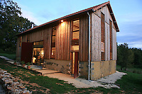 The old tobacco barn has been converted to leave as many original features intact, such as the wooden ventilation slats, and has been designed with a feel for both the rustic and the indusrial