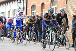 The chasing pack of riders pass over the cobbles of Paddestraat in Zottegem  during the 56th edition of the E3 Harelbeke, Belgium, 22nd  March 2013 (Photo by Eoin Clarke 2013)