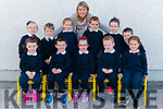 Principal Claire O'Halloran with her new junior infants front l-r Aoife O'Donoghue, Leo Barry, Leah Doherty, Callum O'Connor and Saoirse Murphy, back l-r Caoimhe Darmody, Chase Barton, Amy Reen, Ryan Lowe, Danielle Doherty and Adam O'Sullivan on their first day of school in Barruduff NS last Monday.