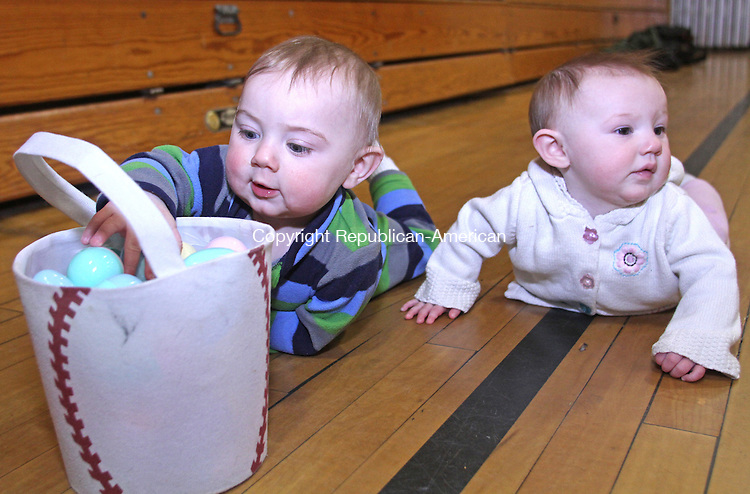 Winsted, CT-032313MK14  Seven month old twins Simon and Temperence Perusse crawl over to inspect the eggs their two old brother Robert Perusse found during the annual easter egg hunt at Person School in Winsted on Saturday morning.  Tricia Twomuy, parks and recreation director, said that volunteers placed 1500 eggs for the activity.  Approximately 150 children participated in two different aged group hunts.  One was for toddlers to four years and one for five to eight year olds. Michael Kabelka Republican American