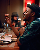 USA, California, Los Angeles, man holding and eating pizza at Pizzeria Mozza.