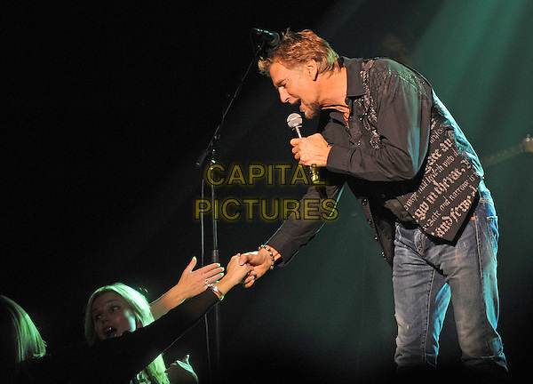 Singer/songwriter KENNY LOGGINS performs at a stop on his 2012/2013 tour held at the Carnegie Library Music Hall of Homestead, Munhall, PA., USA..December 4th, 2012.on stage in concert live gig performance performing music half length black shirt guitar goatee facial hair side profile fans crowd hand arm touching .CAP/ADM/JN.©Jason L Nelson/AdMedia/Capital Pictures.