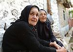 Lin-Pogradec-Albania - August 02, 2004---Two elderly women at/from the village of Lin taking a rest in front of a house; region/village of project implementation by GTZ-Wiram-Albania (German Technical Cooperation, Deutsche Gesellschaft fuer Technische Zusammenarbeit (GTZ) GmbH); people-portrait---Photo: © HorstWagner.eu