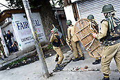 Soldiers from the paramilitary force, Central Reserve Police Force (CRPF) are seen retaliating by throwing stones back at the Kashmiri demonstrators who raised anti-India slogans, threw stones and clashed with Indian police during an anti-election protest in downtown Srinagar, summer capital of Jammu and Kashmir, India. A 50 hour curfew was imposed on May 5th to boycott the elections on May 7, 2009. ..Kashmir went into polls on the 4th round of Indian general elections. About 26 percent polling was recorded in the Indian parliamentary elections held in Kashmir on Thursday, May 7th 2009. The poll percentage was on the higher side this year as compared to 2004 polls when 15.04 percent polling was recorded.