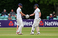 Tom Westley of Essex congratulates Alastair Cook (L) on reaching his fifty during Worcestershire CCC vs Essex CCC, Specsavers County Championship Division 1 Cricket at Blackfinch New Road on 12th May 2018