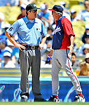 24 July 2011: Washington Nationals Manager Davey Johnson (right) has words with umpire Mike DiMuro after a call in favor of the Los Angeles Dodgers at Dodger Stadium in Los Angeles, California. The Dodgers defeated the Nationals 3-1 to take the rubber match of their three game series. Mandatory Credit: Ed Wolfstein Photo