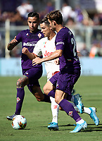Calcio, Serie A: Fiorentina - Juventus, stadio Artemio Franchi Firenze 14 settembre 2019<br /> Juventus' Cristiano Ronaldo (c) in action with Fiorentina's Pol Lirola (r) and Erick Pulgar (l) during the Italian Serie A football match between Fiorentina and Juventus at Florence's Artemio Franchi stadium, September 14, 2019. <br /> UPDATE IMAGES PRESS/Isabella Bontto