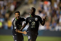 Eddie Johnson (9) of the MLS All-Stars celebrates his game-winning goal with teammates Steven Beitashour (33) during the game at PPL Park in Chester, PA.  The MLS All-Stars defeated Chelsea, 3-2.