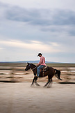 USA, Nevada, Wells, cowboy and wrangler Clay Nannini rides around the expansive 900 square mile property in NE Nevada, Mustang Monument, A sustainable luxury eco friendly resort and preserve for wild horses, Saving America's Mustangs Foundation