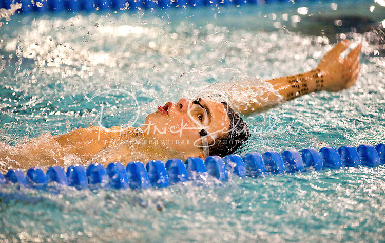 A 12-year-old swimmer compete at a swim meet competition in North Carolina. Photo is model released for commercial use.