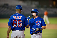 AZL Cubs catcher Marcus Mastrobuoni (5) fist bumps with assistant hitting coach Leonel Perez (66) during Game Three of the Arizona League Championship Series against the AZL Giants on September 7, 2017 at Scottsdale Stadium in Scottsdale, Arizona. AZL Cubs defeated the AZL Giants 13-3 to win the series two games to one. (Zachary Lucy/Four Seam Images)