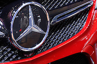 The Mercedes Benz logo is pictured while people attend the International Auto Show 2015 in New York. 04.06.2015. Eduardo MunozAlvarez/VIEWpress.