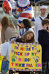 Cathy Palmer holds a sign greeting her father, Lt. Mike Palmer who's stationed onboard the USS John C. Stennis, a 1,092-foot-long aircraft carrier that's  homepdort at Naval Station Kitsap in Bremerton, WA. on July 10, 2009 The carrier and it's 3,200 crewmember arrived early Friday after spending a six-month deployment in support of  Middle East operations.(© Jim Bryant Photo. All Rights Reserved 2009)