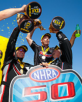 Jul 28, 2019; Sonoma, CA, USA; (From left) NHRA top fuel driver Billy Torrence, pro stock driver Greg Anderson and funny car driver Robert Hight celebrate after winning the Sonoma Nationals at Sonoma Raceway. Mandatory Credit: Mark J. Rebilas-USA TODAY Sports