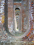 Pattern of brick arches in the railway viaduct opened in 1849, Chappel, Essex, England