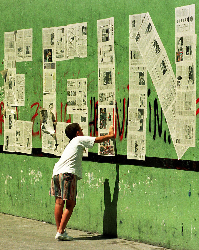 Basque Country, Europe:<br /> A child watching the latest issue of the newspaper Egin after its closure by court order.<br /> Argazkia / Photo: Ander Gillenea