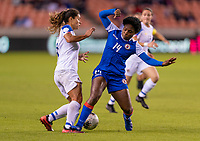 HOUSTON, TX - JANUARY 31: Raquel Rodriguez #11 of Costa Rica is fouled by Phiseline Michel #14 of Haiti during a game between Haiti and Costa Rica at BBVA Stadium on January 31, 2020 in Houston, Texas.