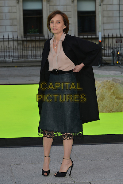 Kristin Scott Thomas<br /> Royal Academy Summer Exhibition Preview Party 2013, London, England 5th June 2013<br /> full length black coat green skirt lace beige blouse <br /> CAP/PL<br /> &copy;Phil Loftus/Capital Pictures