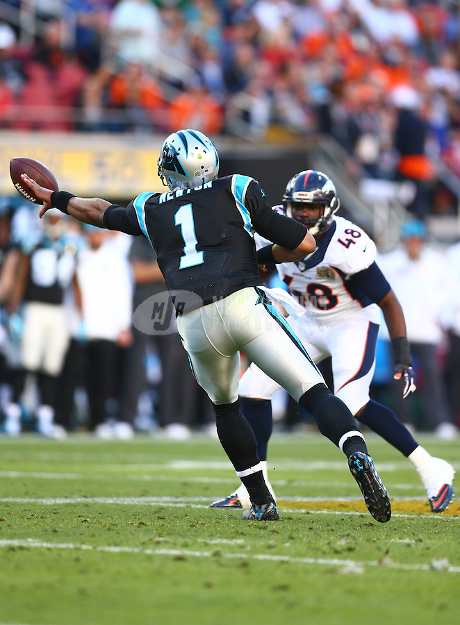 Feb 7, 2016; Santa Clara, CA, USA; Carolina Panthers quarterback Cam Newton (1) reverse lateral passes the ball against the Denver Broncos during Super Bowl 50 at Levi's Stadium. Mandatory Credit: Mark J. Rebilas-USA TODAY Sports