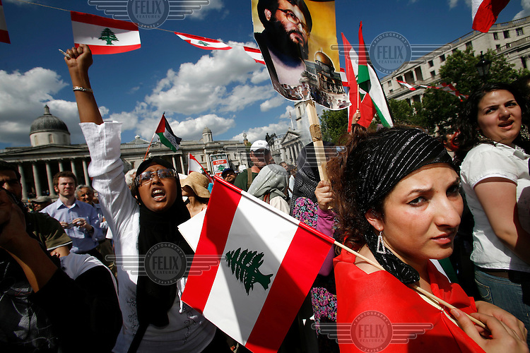 Protesters with Lebanese flags and images of Hezbollah (Hizbollah) leader Hassan Nasrallah at an anti-Israel demonstration. Israel had launched attacks on Palestine and Lebanon in retaliation for the capture of three of its soldiers.