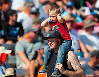 Oct 27, 2018; Las Vegas, NV, USA; A young fan covers his ears on a mans shoulders during NHRA qualifying for the Toyota Nationals at The Strip at Las Vegas Motor Speedway. Mandatory Credit: Mark J. Rebilas-USA TODAY Sports
