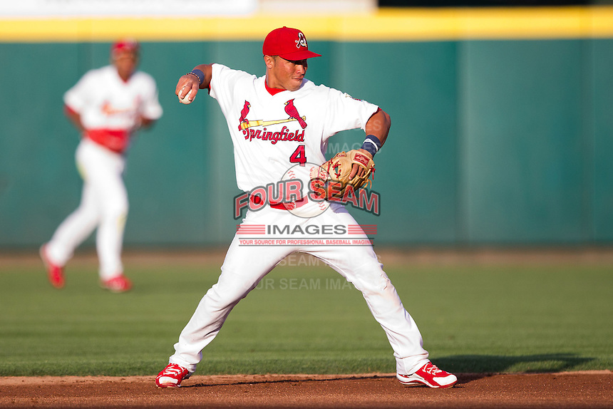 Kolten Wong (4) of the Springfield Cardinals throws to first base during a game against the Arkansas Travelers at Hammons Field on June 13, 2012 in Springfield, Missouri. (David Welker/Four Seam Images).