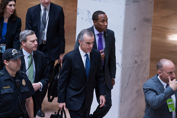 "UNITED STATES - MAY 11: Acting FBI Director Andrew McCabe, center, leaves a Senate (Select) Intelligence Committee hearing in Hart Building titled ""World Wide Threats"" on May 11, 2017. (Photo By Tom Williams/CQ Roll Call)"