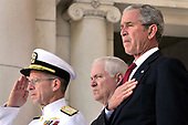 United States President George Bush, right, US Navy Admiral Mike Mullen, Chairman of the Joint Chiefs of Staff, left, and US Secretary of Defense Robert Gates, center, bow their heads at the Arlington National Cemetery on Memorial Day, May 26, 2008 in Arlington, Virginia. <br /> Credit: Ken Cedeno / Pool via CNP