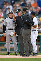 Home plate umpire Jim Joyce explains the ground rules to New York Yankees coach Mick Kelleher at Comerica Park April 27, 2009 in Detroit, Michigan.  Photo by Brian Westerholt / Four Seam Images
