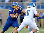 BROOKINGS, SD - SEPTEMBER 10:  Cole Langer #54 from South Dakota State tracks down Grant Kraemer #15 from Drake during their game at the Dana J. Dykhouse Stadium Saturday night in Brookings. (Photo by Dave Eggen/Inertia)