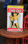 Cola-Cao chocolate drink advertising on vintage tin in street market , Spain