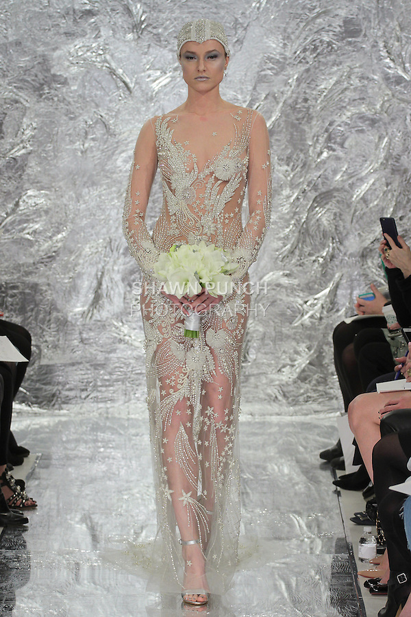"""Model Aida Aniulyte walks runway in Nyota - an ivory hand embroidered """"Galaxy"""" bridal gown from the Theia Spring 2017 bridal collection by Don O'Neill, during New York Bridal Fashion Week Spring Summer 2017 on April 14, 2016."""