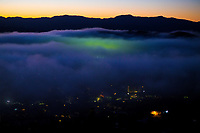 Fog rolls in over the National Hockey Stadium and Newtown at 6.30am in Wellington, New Zealand on Monday, 18 May 2020. Photo: Dave Lintott / lintottphoto.co.nz
