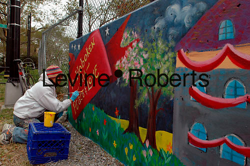 (SPEC 1.4d)    Finishing touches on The Hoboken Community Mural Project, painted on the retaining wall of the Little League Field. Stevens Park, Hoboken, New Jersey.  The mural celebrates Hoboken's 150th Anniversary.  it will be dedicated October 29, 2005. (© Frances M. Roberts)