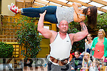 Pictured at the Duagh parish festival on Saturday was Irelands Strongest Man Patrick O'Dwyer who is pictured here lifting his sister Kristine Horan over his head in Jim's Bar Daugh.