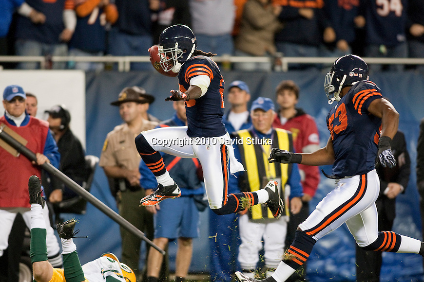 Chicago Bears punt returner Devin Hester (23) leaps into the endzone during an NFL football game against the Green Bay Packers in Chicago, Illinois on September 27, 2010. The Bears won the game 20-17. (AP Photo/David Stluka)
