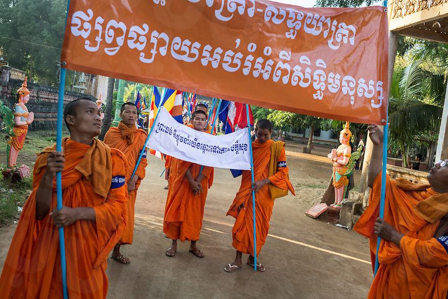 December 04, 2013 - Kampong Thom, Cambodia. Monks and activists prepare to leave a pagoda during a 10 day Human Rights march through the country. © Nicolas Axelrod / Ruom