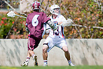 Los Angeles, CA 03/20/10 - Kelcey Fisher (LMU # 16) and Justin Ghio (Arizona # 13) in action during the Arizona-Loyola Marymount University MCLA game at Leavey Field (LMU).  LMU defeated Arizona 13-6.