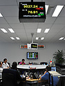 August 10, 2011, Tokyo, Japan - The weakened U.S. dollar gets yet weaker as the green buck is being traded at the 76 to 77-yen level on the Tokyo foreign exchange market during the morning session on Wednesday, August 10, 2011. (Photo by Natsuki Sakai/AFLO) [3615] -mis-