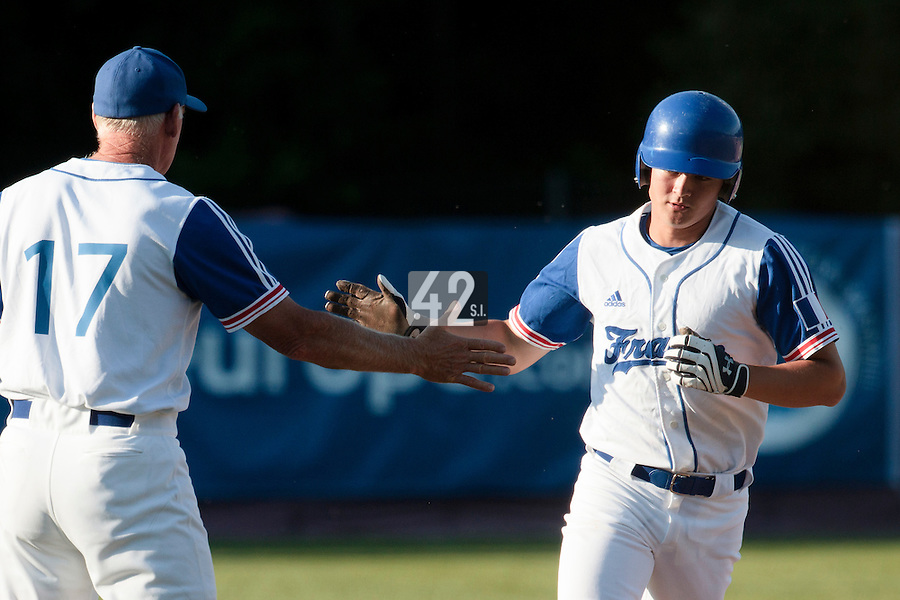 31 July 2010: Kenji Hagiwara of Team France is congratulated by John Haar as he runs the bases after his solo homerun during the Greece 14-5 win over France, at the 2010 European Championship, in Heidenheim, Germany.