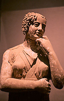 """Greek Art:  Late Classic Group--The Listening Siren.  """" Each figure retains a large amount of color underneath brown-grey encrustration.""""  Getty Museum, Malibu."""