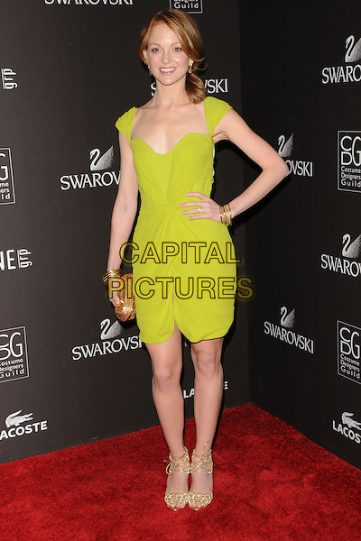 JAYMA MAYS.The 12th Annual Costume Designers Guild Awards held at The Beverly Hilton Hotel in Beverly Hills, California, USA. .February 25th, 2010 .full length green dress shoes hand gold bracelets clutch.CAP/RKE/DVS.©DVS/RockinExposures/Capital Pictures.