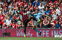 Jermain Defoe of AFC Bournemouth & Bernardo Silva of Manchester City during the Premier League match between Bournemouth and Man City at the Goldsands Stadium, Bournemouth, England on 26 August 2017. Photo by Andy Rowland.