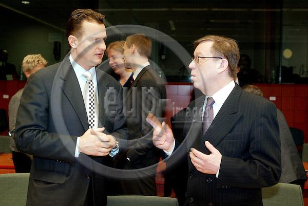 BRUSSELS - BELGIUM - 19 MARCH 2004--EU-Council meeeting of Interior -, and Justice Ministers. --Kari RAJAMÄKI (Rajamaki, Rajamaeki) (R) the Finnish Internal Affairs Minister and Eriks JEKABSONS (L) the Latvian Minister for Internal Affairs. -- PHOTO: JUHA ROININEN / EUP-IMAGES